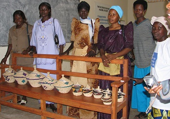 Women entrepreneurs at The Hunger Project-Uganda's Iganga epicenter in 2008 with their hand-crafted baskets.